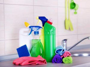 a variety of colorful cleaning supplies